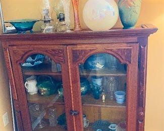 Antique cabinet, some Roseville pottery, antique glassware