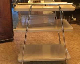 Mid-Century Modern style shows in this handy utility or bar cart.