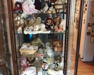 One of 2 matching lighted double glass framed front door curio cabinets! Filled with collectible doll figurines! MATCHING CABINETS SOLD!