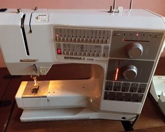 Like new Bernina 1130 sewing machine with arrachmants and lift cabinet