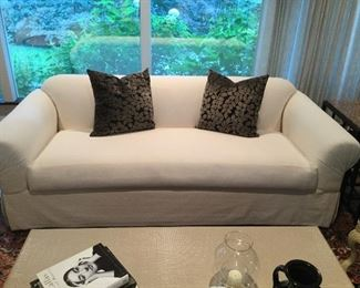"""Cream rolled arm skirted couch 86"""" x 40"""""""