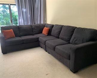 Gray upholstered sectional sofa
