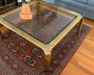 Brass and Glass coffee table and oriental  rug