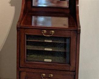 $525 Edwardian music cabinet drop front glazed mahogany with beveled glass mirror . 44x20x15
