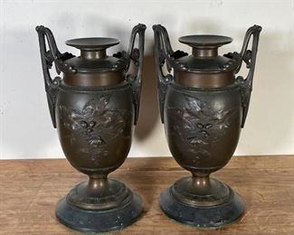 PAIR BRONZE URNS   Heavy and solid, with flower and leaf design to body with leafy scrollwork handles; h. 13 x w. 7 in.
