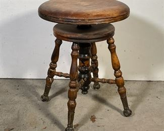 ANTIQUE WOOD STOOL   Round seat swiveling seat over turned wood legs and stretcher with iron-capped feet; h. 19 x dia. 14 in.