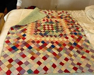 Checkerboard pattern antique hand made child's quilt. Made by my grandmother.