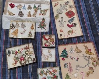 Large collection of vintage Christmas pins including tree, reindeer, snowman, santa's, wreaths, and presents!