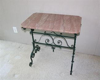 """Gorgeous antique c. 1920's pink marble topped hand wrought iron table 30"""" wide, 20"""" deep, and 30"""" tall.  Note the rounded edge on the marble top (and the canted corners!) in superb antique condition!"""