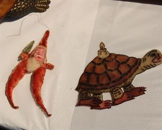 Victorian era ornaments! Vellum tortoise with articulated legs and a candle on his back!  We just dug out the Christmas -- tubs and tubs and tubs of it!  Antique/Vintage/Modern!
