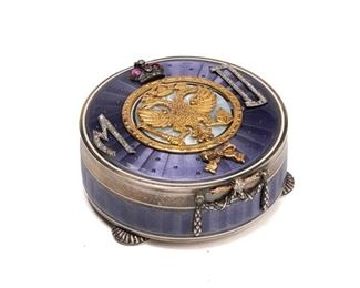 """1001 A Fabergé-Style Guilloché Snuffbox Circa 1908-1917 Bears Faberge-style hallmark; Further marked with right-facing kokoshnik mark with Greek alpha for St. Petersburg and """"AH"""" The silver footed snuffbox with lavender-colored guilloche enamel set with diamonds and centering a gold double-headed eagle with crown, orb, and scepter over a white guilloche enamel plaque, flanked by the monogram """"MD"""" 1"""" H x 2.25"""" Dia. 83 grams Estimate: $2,500 - $3,500"""