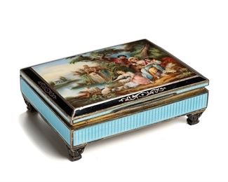 """1007 An Austrian Sterling Silver And Guilloché Vanity Box First-quarter 20th Century Marked: Made in Austria / 3 / Sterling Silver The sterling silver rectangular vanity box with a hinged lid decorated with a painted enamel pastoral courting scene over light blue guilloche enamel sides and raised on four feet 1.75"""" H x 5.375"""" W x 4.125"""" D Estimate: $2,000 - $3,000"""