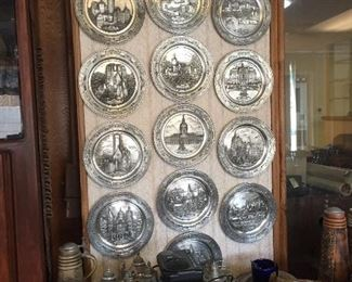 Pewter plates, steins and statuary.