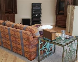 Sofa, entertainment cabinets by Grazier, electronics, end table