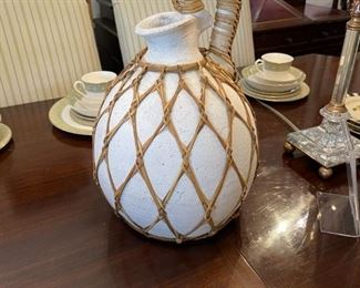 Wicker and clay water pitcher