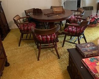 Oak table and 6 hickory chairs in master bedroom
