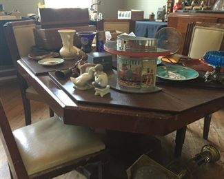 Mid-Century Modern MCM Art Deco dining room table with eight chairs and leaves.