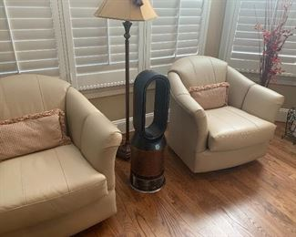 PAIR OF MATCHING LEATHER SWIVEL ROCKERS