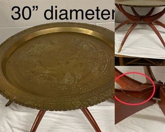 Brass top Spider table.  Legs fold and top can be hung as wall decor