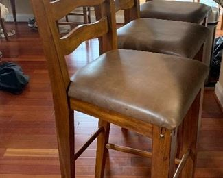 Leather and wood bar stools very sturdy