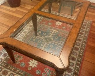 Leather trimmed glass top cocktail table see matching side tables and Tuscan leather loveseat