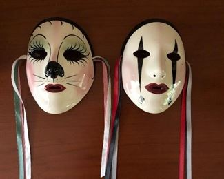 """""""Fancy Faces"""" porcelain masks Mardi Gras from New Orleans. (8"""" x 6"""" x 2"""" left & 7"""" x 6"""" x 2"""" right) Excellent condition and ready to wall mount. Asking $30 each."""