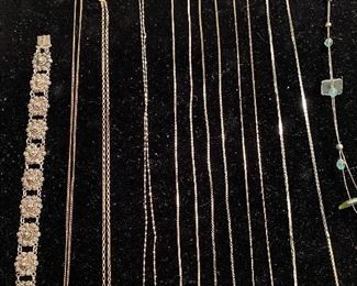 Numerous chains and pendants, including some sterling.
