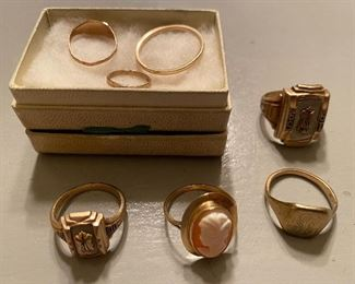 Gold rings, including a couple of class rings, rings for a baby and a child, and more.