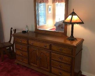 Beautiful triple oak dresser w/mirror.