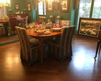 Dining Table, similar styling as the hutch with 6 slip covered chairs and two leaves.  Large folk art picture too!