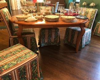 Two additional leaves for this oval table.