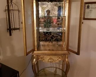 Gold display case, metal glass top table, iron candle holder