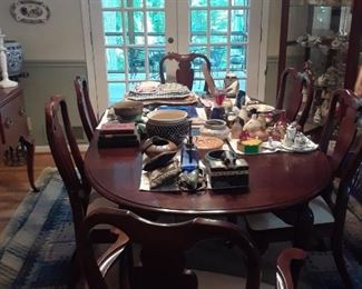 Oval dining room table with one  leaf and 6 Queen Anne style dining chairs, 2 armchairs and 4 side chairs