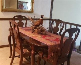 Dining set has an additional leaf and protective coverings