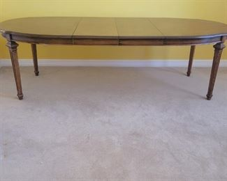 Neoclassical Oval Wooden Dining Table with 2 Leaves