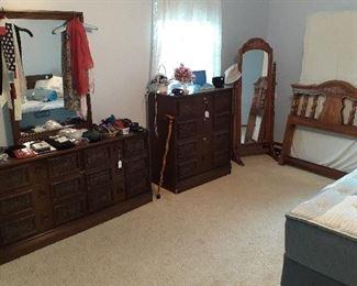 dressers, twin bed, floor standing mirror