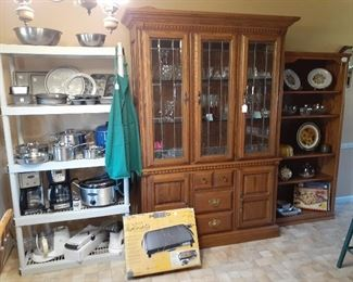 china cabinet, Tilt & Drane grill, Cuisanart coffee, toaster oven, pots and pans, Black & Decker coffee, Mandolin slicer, GE food processor, Food Saver/bags, Chef's Choice knife sharpener, stainless pots and pans