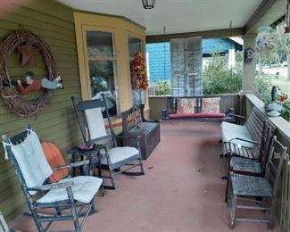 Porch rockers, swings, bench, wreaths.