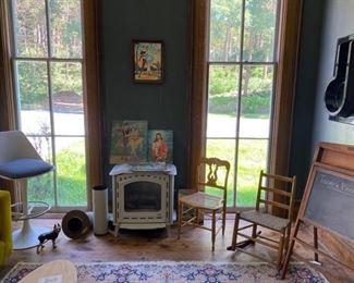 MCM gas burning stove, primitive chairs, 1970s stool, carpet.