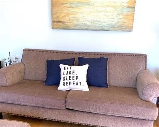 there are two of these matching sofas & each has a matching ottoman