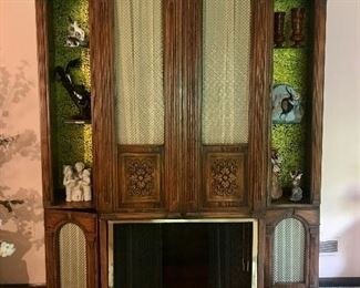 Mid-century curio, media, dry bar cabinet with fireplace compartment (closed).