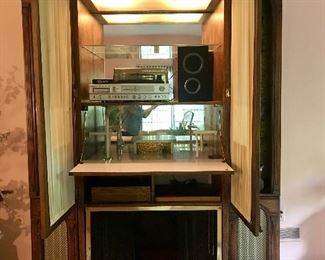 Mid-century curio, media, dry bar cabinet with fireplace compartment with automatic light when open.