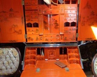 inside of Maitland Smith Chinoiserie Secretary, black laquer outside, Hermes orange inside