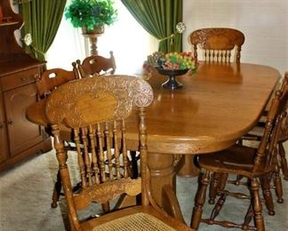 Very large formal Dinette set w/ three attached leaves. Beautiful!!