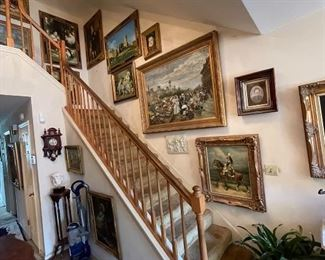 Many large framed printed paintings