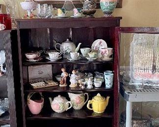 Vintage cherry cabinet with glass door full of treasures! Teacups, teapots, figurines...