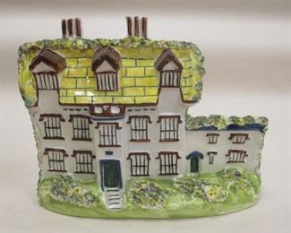 """A STAFFORDSHIRE POTTERY FLAT HOUSE IN THE FORM OF STANFIELD HALL. IMPRESSED 'LEEDS POTTER' MARK, MISSING THE 'Y'. 7"""" WIDE. IMPERFECTIONS ON THE FLOWERS"""