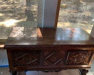 lane cedar chest on legs with carved wood