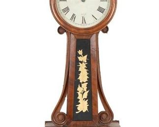 """1009 A Horace Tifft Banjo Wall Clock Second-quarter 19th Century Signed: H. Tifft [Horace Tifft] White painted zinc dial, black Roman numeral hour markers with minute track, and eight-day single train weight-driven brass movement enclosed in a mahogany case with original reverse painted gilt glass tablets featuring gilt floral decoration and eagle on black ground 33"""" H x 10"""" W x 3.5"""" D; Dial 7.75"""" Dia. Estimate: $400 - $600"""