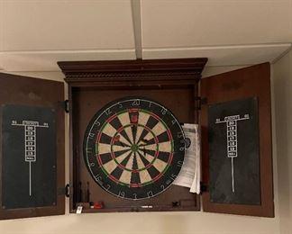 Dartboard with chalk boards encased in a beautiful wood cabinet